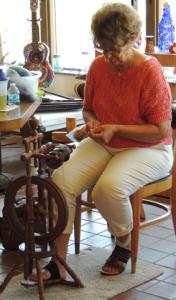 Linda spins on a Colonial Era replica wheel.